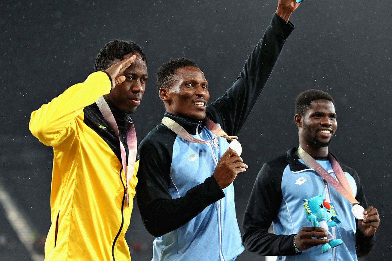 Bronze medallist Javon Francis of Jamaica and Botswanan's gold medallist Isaac Makwala and silver medallist Baboloki Thebe celebrate during the medal ceremony for the men's 400m. / Photo credit: GC2018