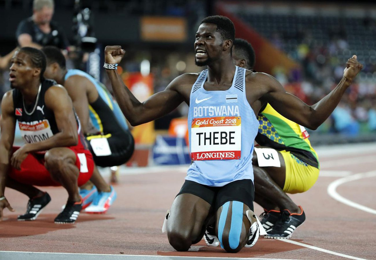 The silver medallist Baboloki Thebe celebrate after the men's 400m final / Photo Credit: Getty