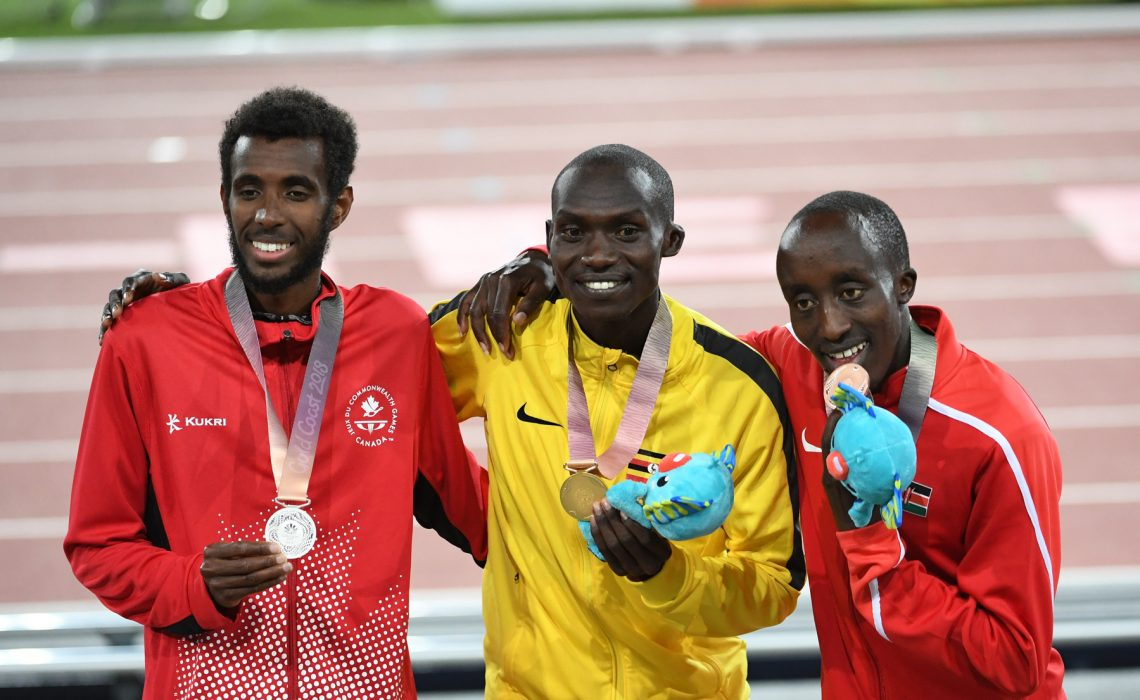 Uganda's Joshua Kiprui Cheptegei and Kenya's Rodgers Kwemoi at Gold Coast 2018 / Photo Credit: Norman Katende