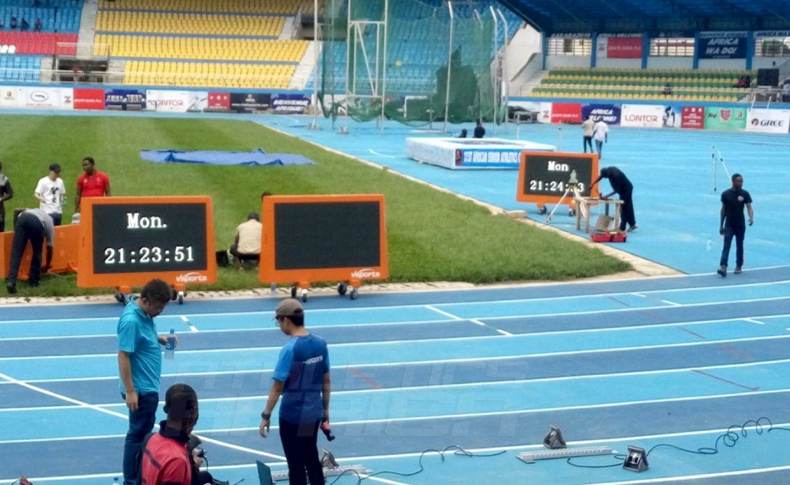 LOC contractors and officials set up the timing equipment at the Stephen Keshi stadium in Asaba on Monday 31 July / Photo credit: Naomi Peters for Athletics Africa