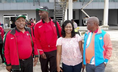 The Chair of the Asaba 2018 LOC, Chief Solomon Ogba, chats with officials of Athletics Kenya during the Kenyan team arrival at the Asaba International Airport for the 2018 African Senior Championships - 31 July, 2018. / Photo: LOC