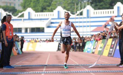 Ethiopia's Andamlak Belihu winning the TCS World 10K Bengaluru 2019 / Photo credit Procam International