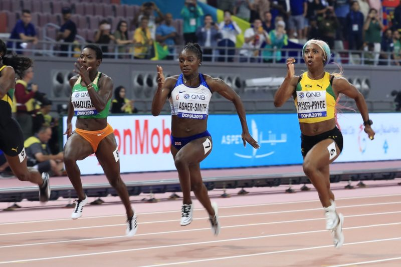 Dina Asher-Smith of Great Britain and Shelly-Ann Fraser-Pryce of Jamaica compete in the Women's 100 Metres final during day three of 17th IAAF World Athletics Championships Doha 2019 at Khalifa International Stadium on September 29, 2019 in Doha, Qatar. (Photo by Andy Lyons/Getty Images for IAAF)