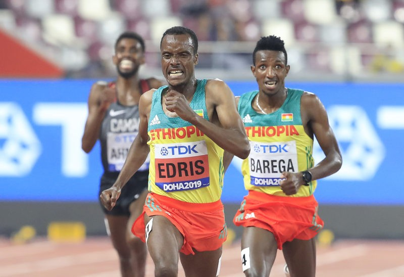 Gold medalist Muktar Edris of Ethiopia and silver medalist Selemon Barega of Ethiopia compete in the Men's 5000 metres final during day four of 17th IAAF World Athletics Championships Doha 2019 at Khalifa International Stadium on September 30, 2019 in Doha, Qatar. (Photo by Andy Lyons/Getty Images for IAAF)