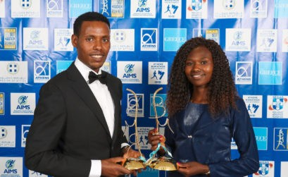 Lelisa Desisa and Ruth Chepngetich with their prizes / Photo credit: Victah Sailer / AMA