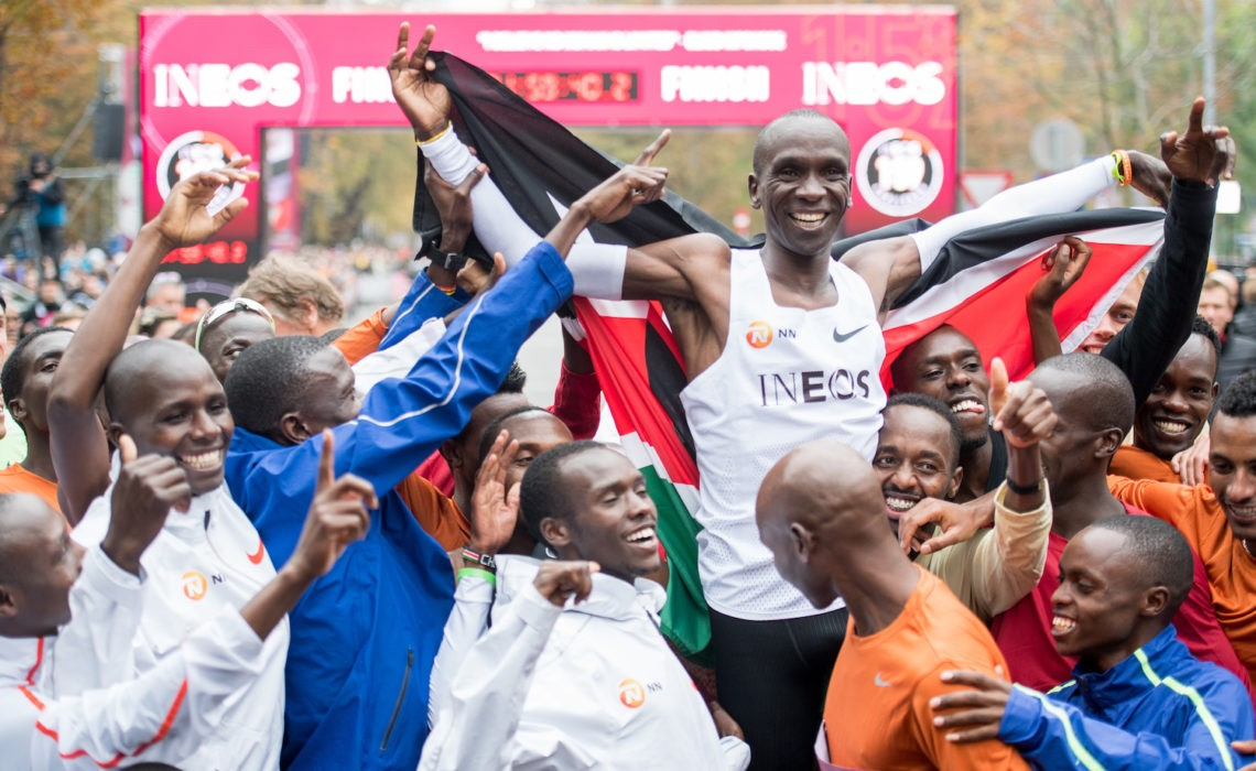 Eliud Kipchoge celebrating with his pacemakers, in Vienna at the finish line. Credit: Vienna City Marathon / Michael Gruber