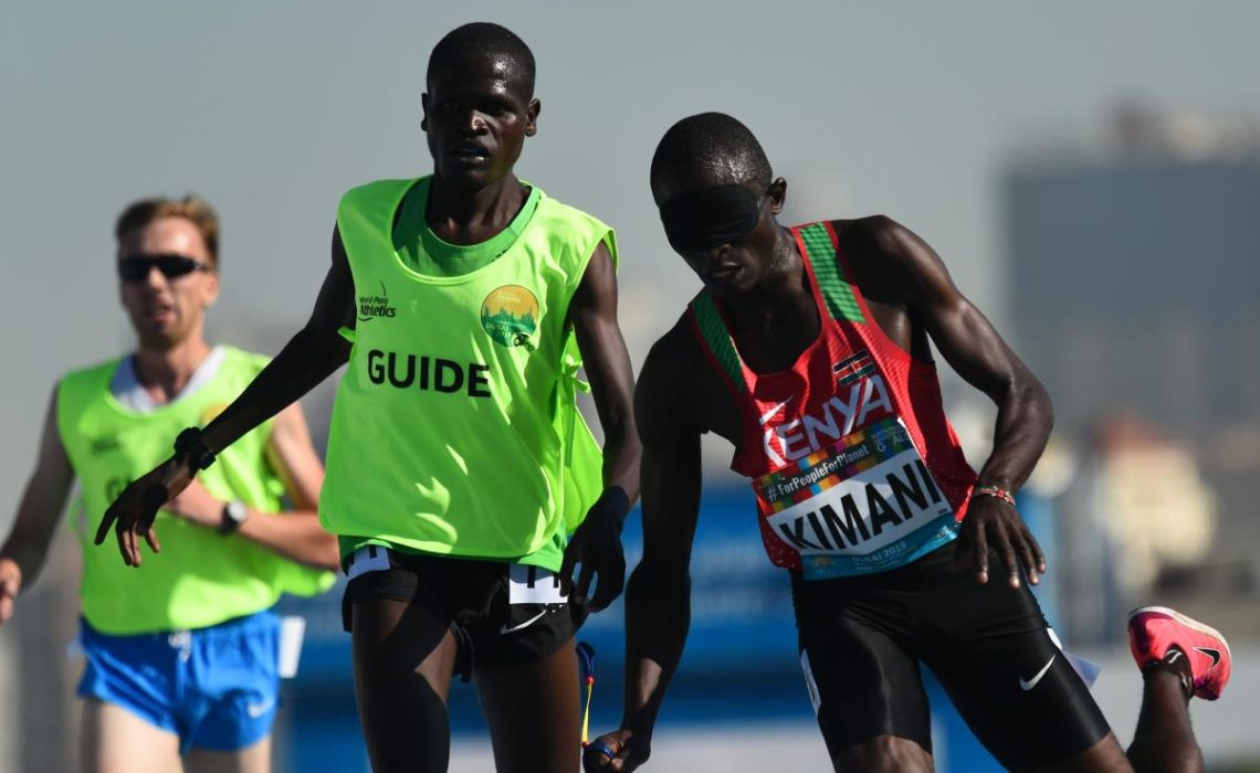 Samwel Kimani of Kenya and guide Boit James crosses the line to clinch gold in the Men's 5000m T11 final at Dubai 2019 World Para Athletics Championships. ⒸGetty Images