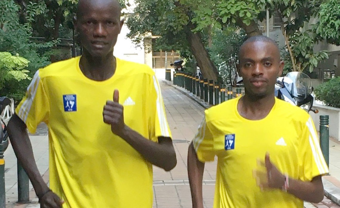 Kenyan runners Rhonzas Kilimo and Daniel Muteti (right) in Athens / Photo credit: AMA / Race News Service.